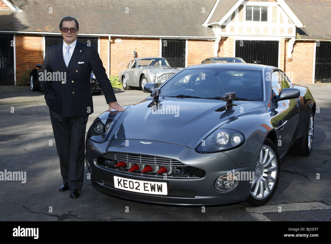 sir roger moore with the aston martin vanquish from the james bond