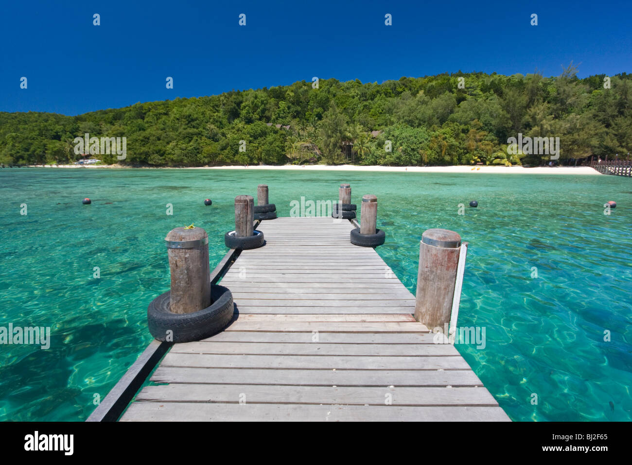 jetty on Manukan island in Sabah Borneo Malaysia with its turquoise water, green vegetation and white sand beaches - Stock Image