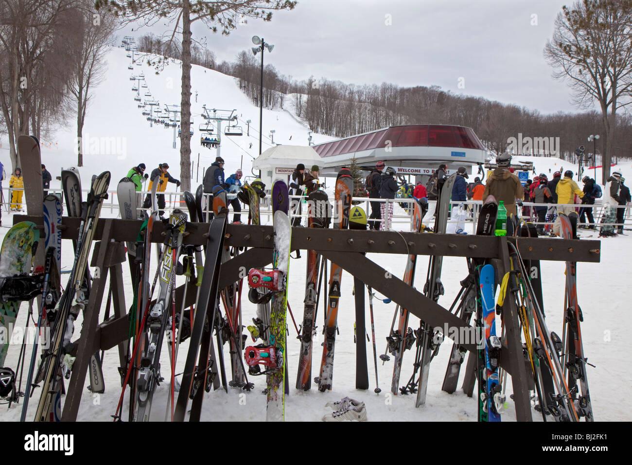 boyne falls, michigan - skis on a rack near a ski lift at boyne