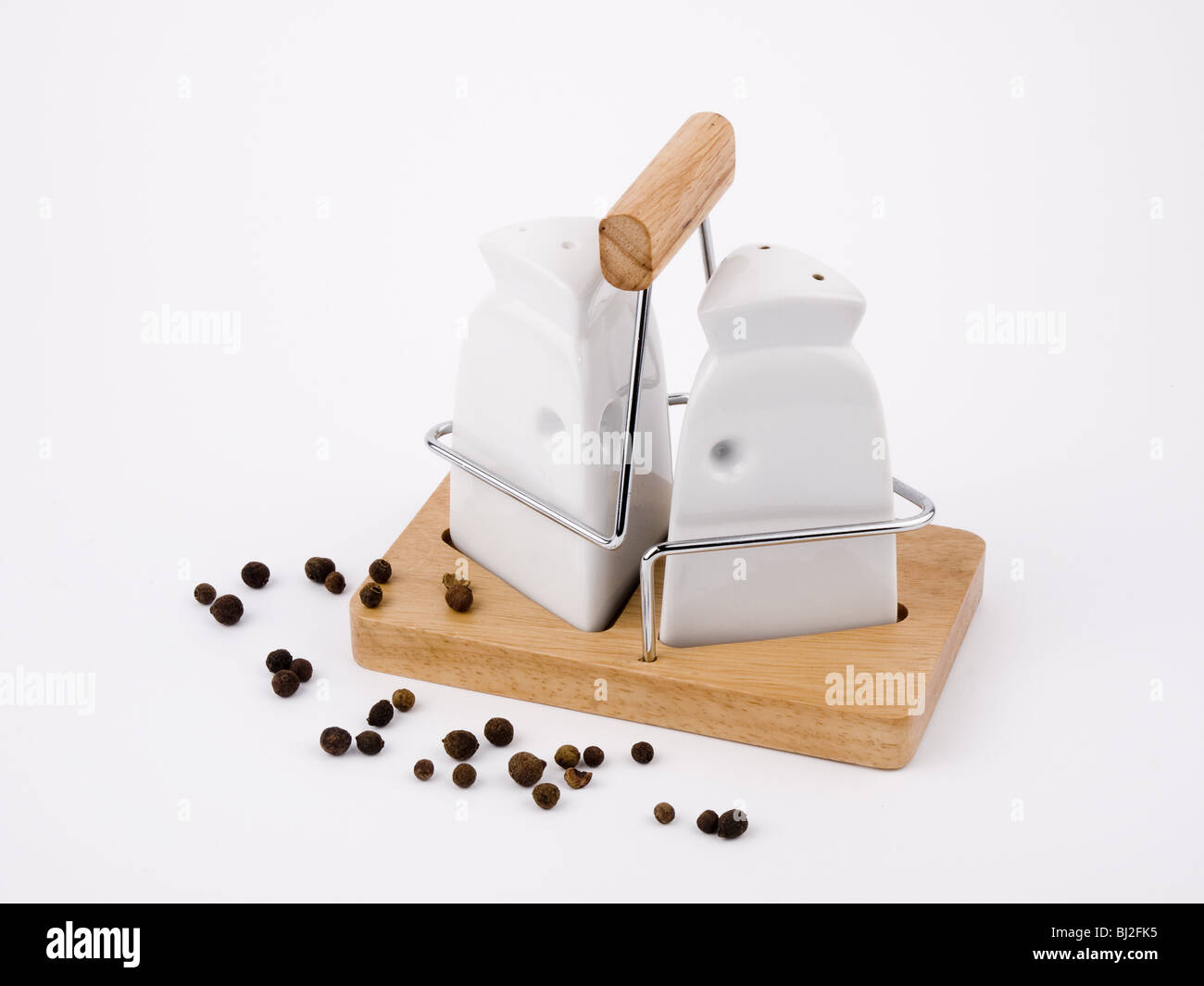 Salt cellar and pepperpot on white background. - Stock Image