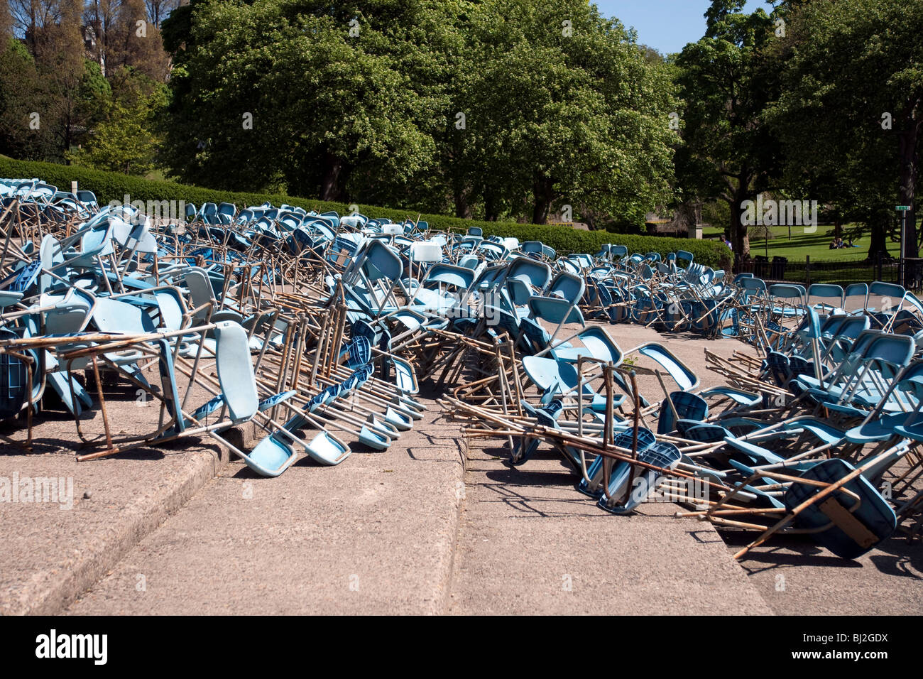 Toppled chairs in the open-air Ross Bandstand in Edinburgh's Princes Street Gardens Stock Photo
