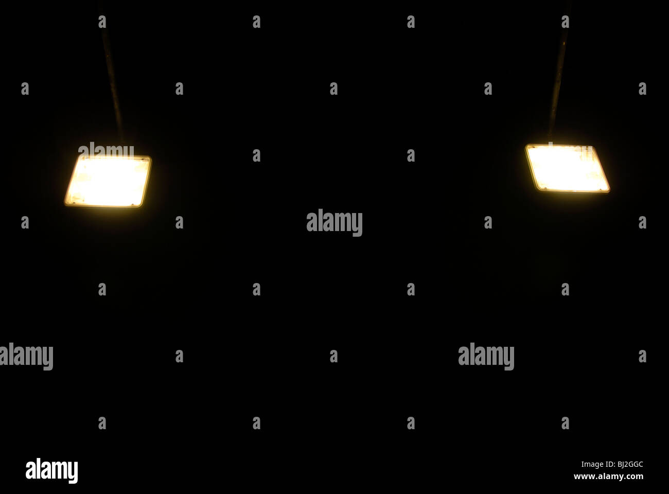 LAMPS AT NIGHT - Stock Image