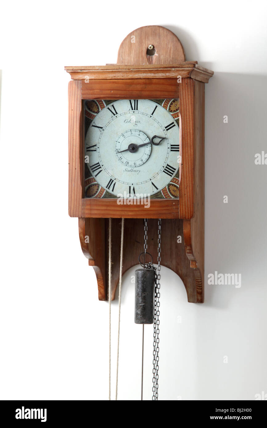 Hooded wall clock - Stock Image