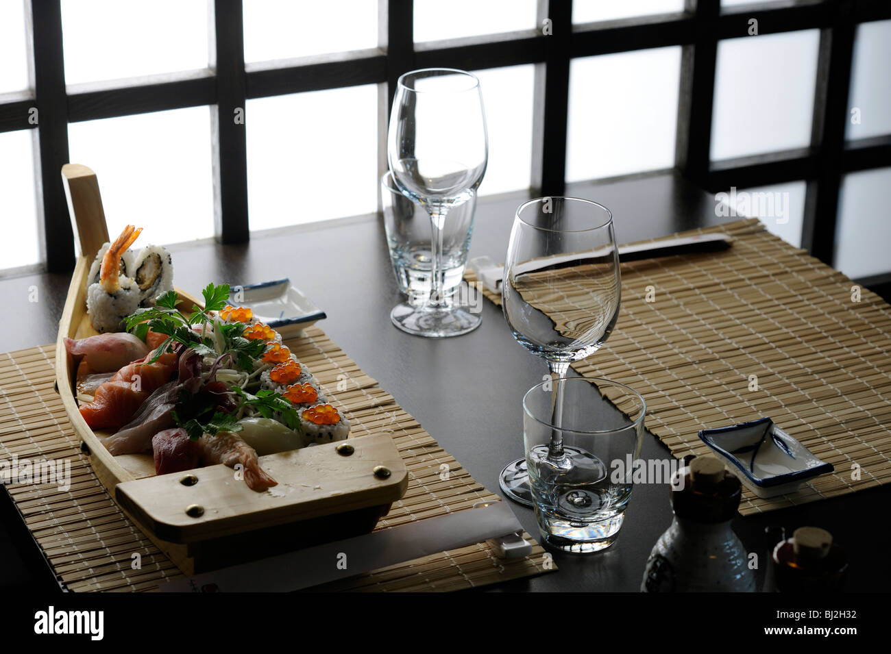 A boat of sushi in a table of elegant Japanese restaurant - Stock Image