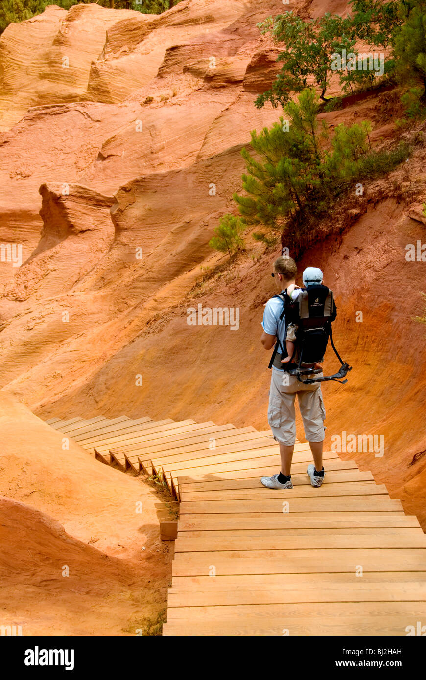 Father and child enter the Ochre Quarries, Roussillon, Provence, France - Stock Image