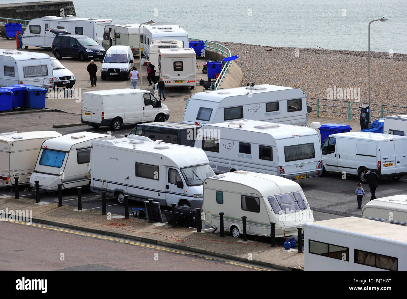 Travellers set up an illegal camp on a public car park at black rock next to brighton marina - Stock Image