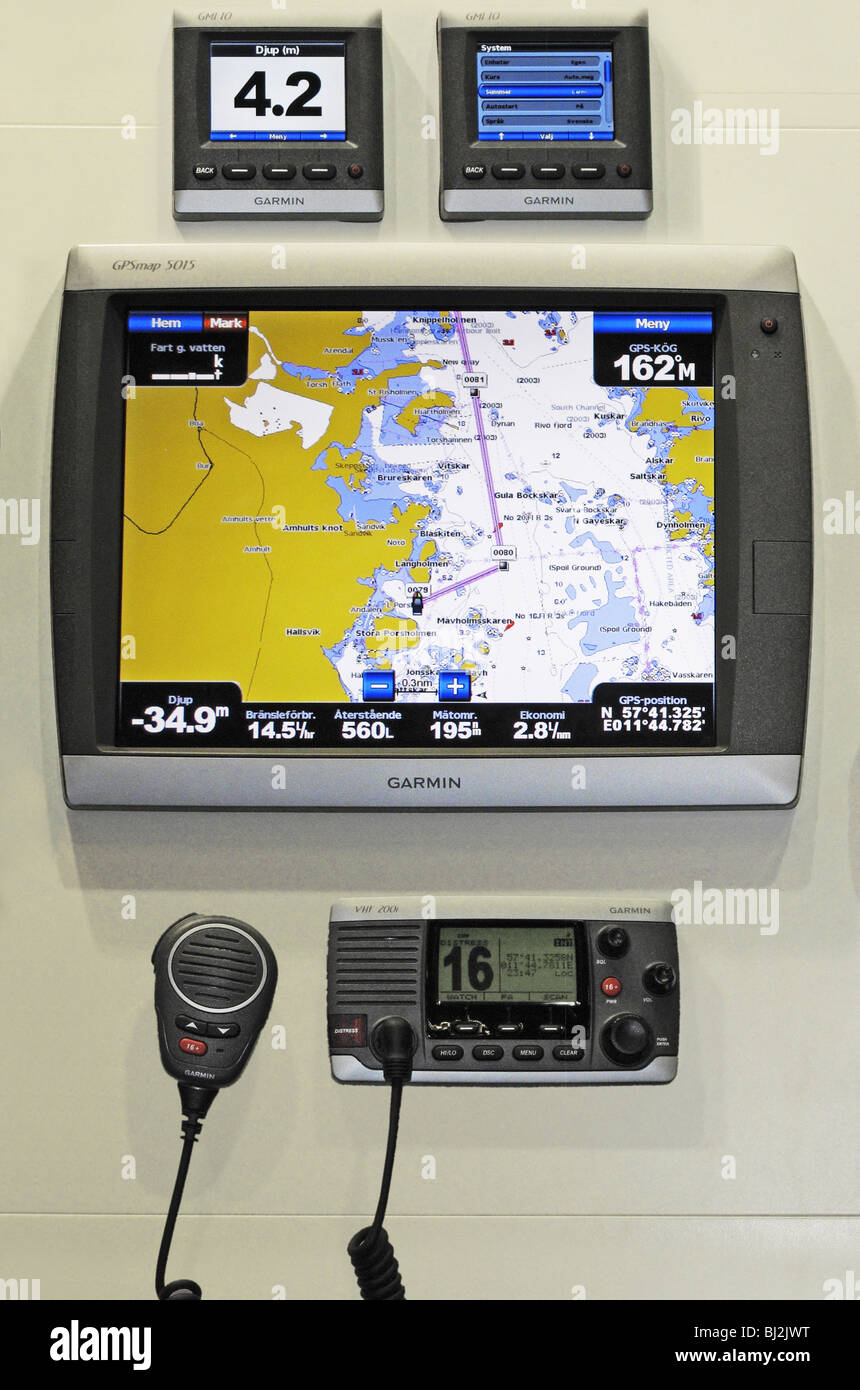 Simple marine navigation instrument consisting of GPS display with addition of Garmin's GMI system and VHF radio. - Stock Image