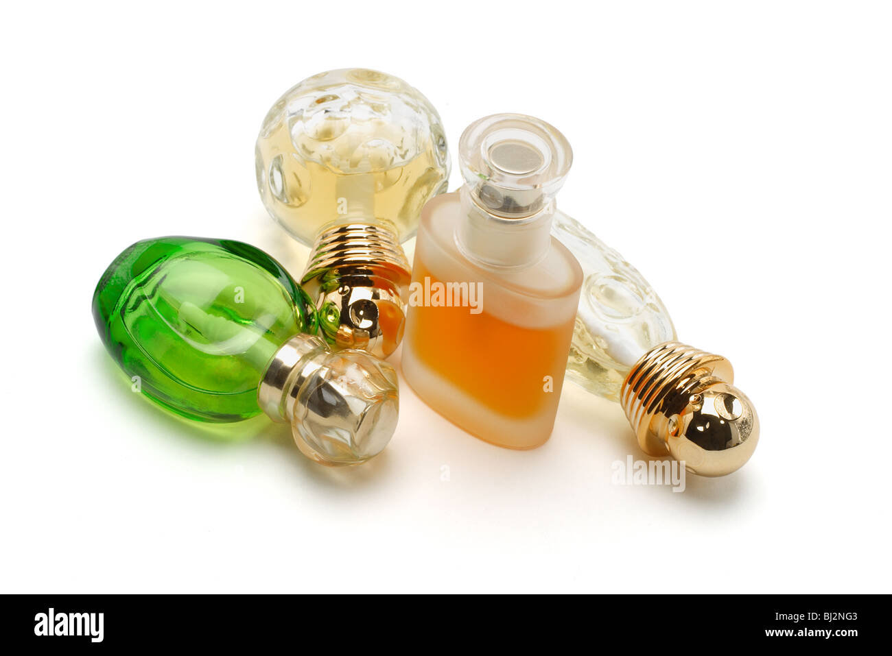 Perfume in glass bottles on white background - Stock Image