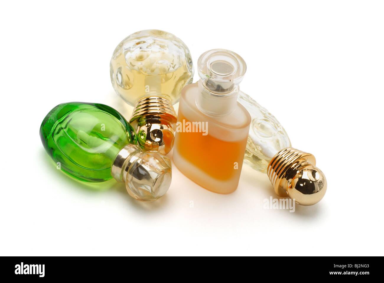Perfume in glass bottles on white background Stock Photo