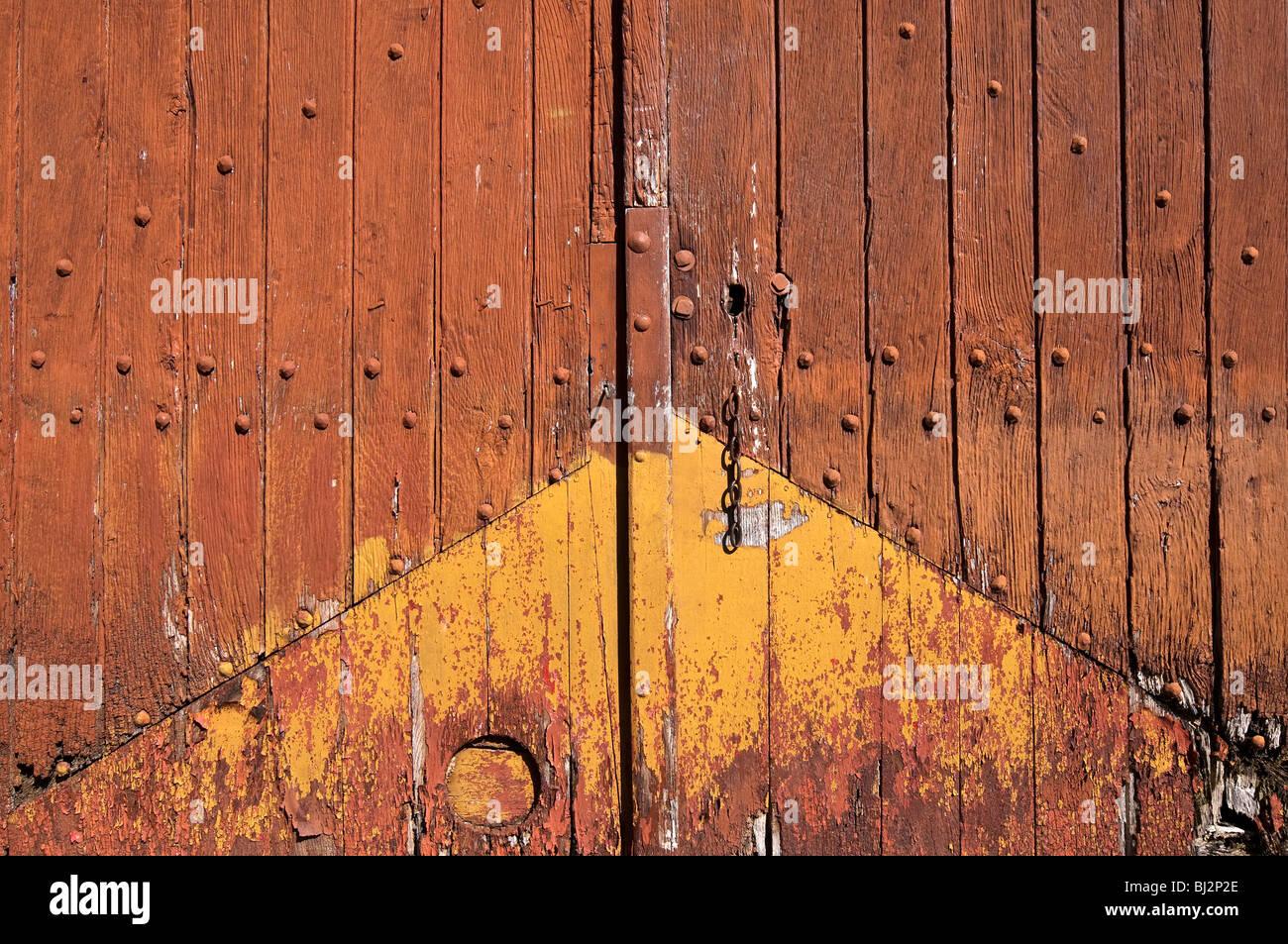 Old repaired wooden garage doors - France. - Stock Image