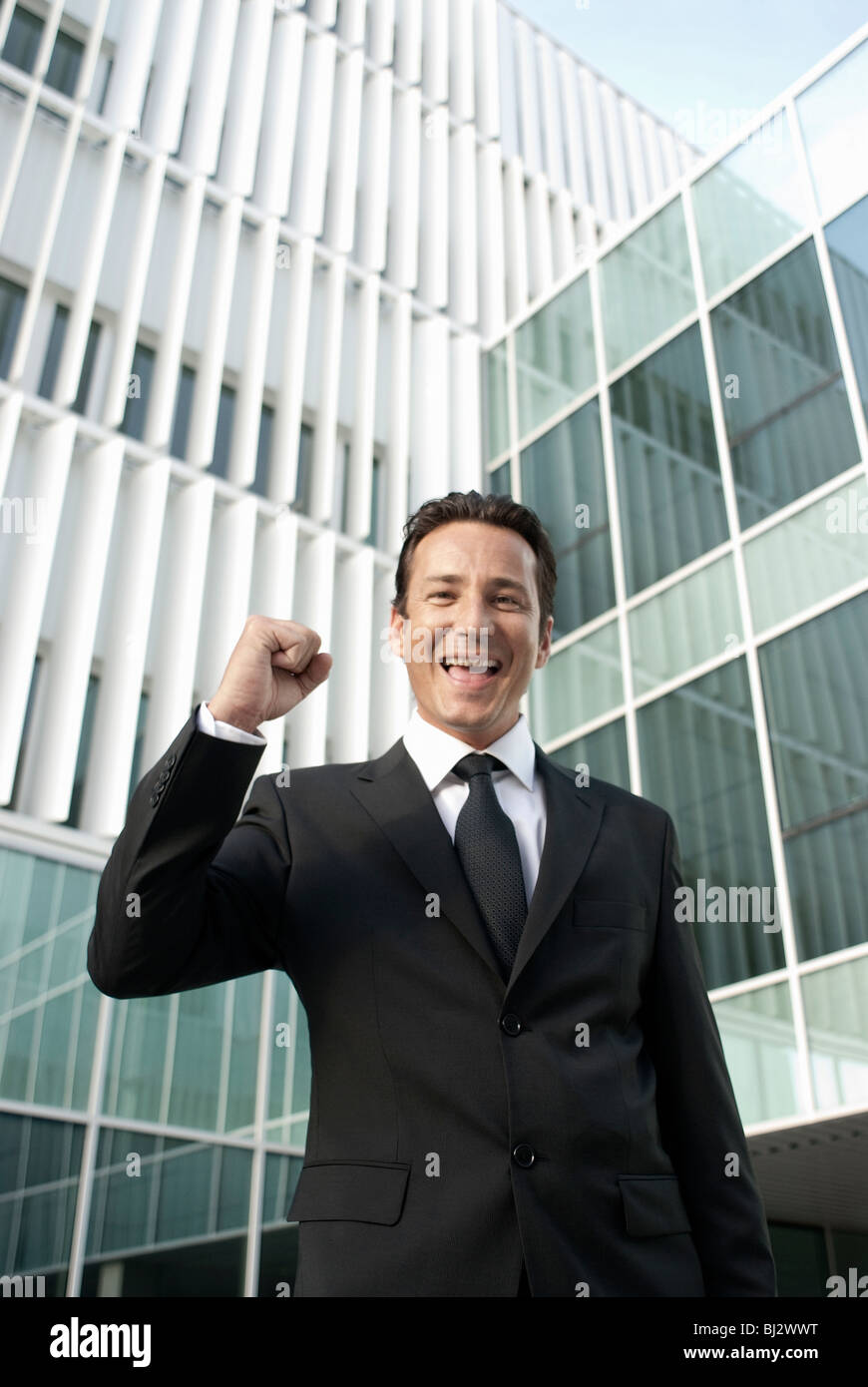 Businessman punching the air - Stock Image