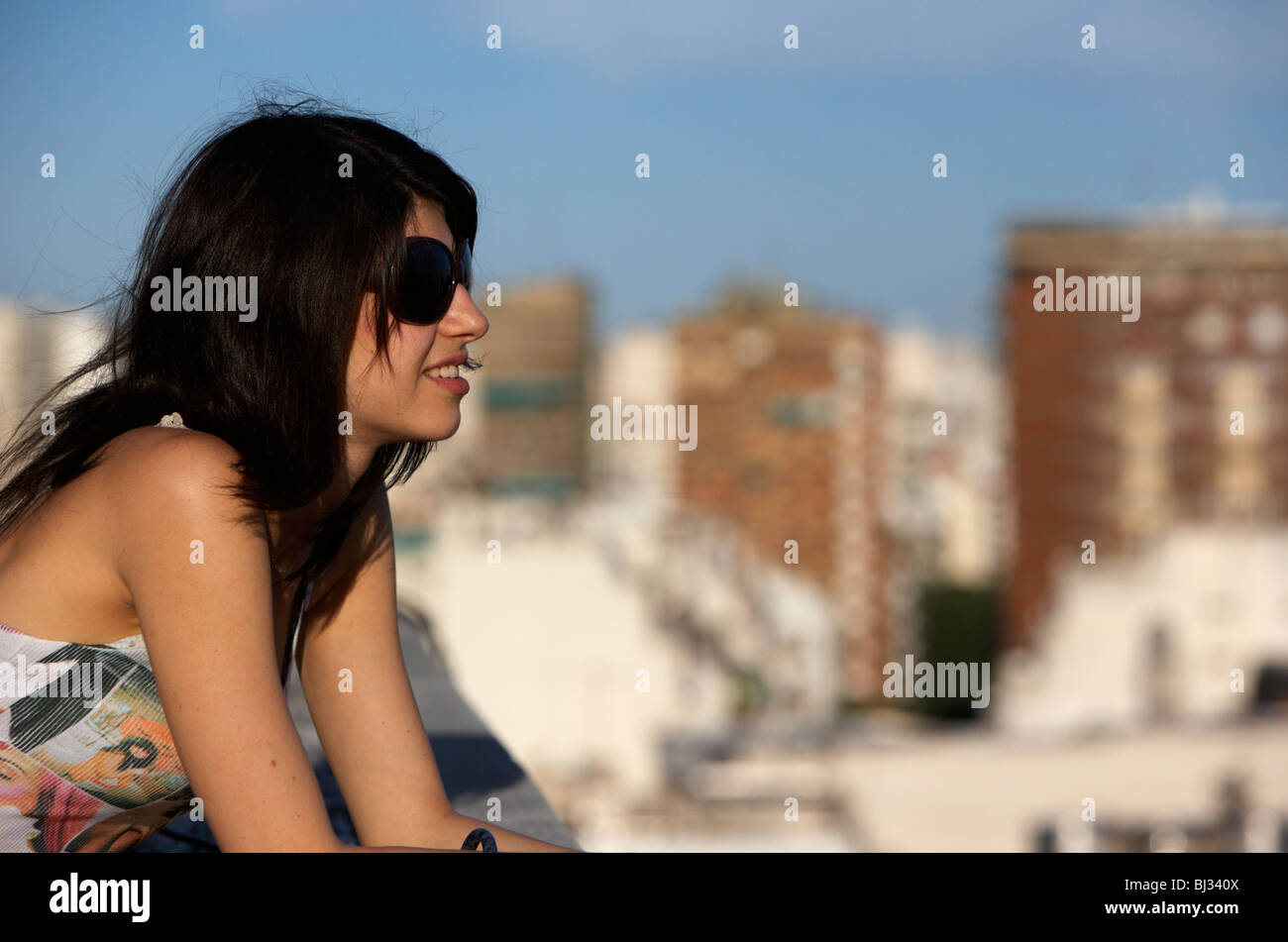 young hispanic latin woman looking out over city buenos aires Stock Photo