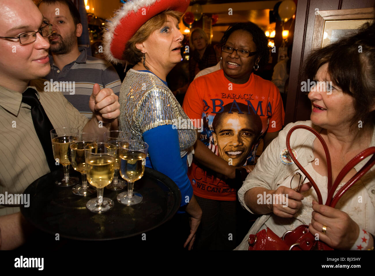 A group of Democratic party supporters look ecstatically happy after the final news of Barack Obama's victory - Stock Image