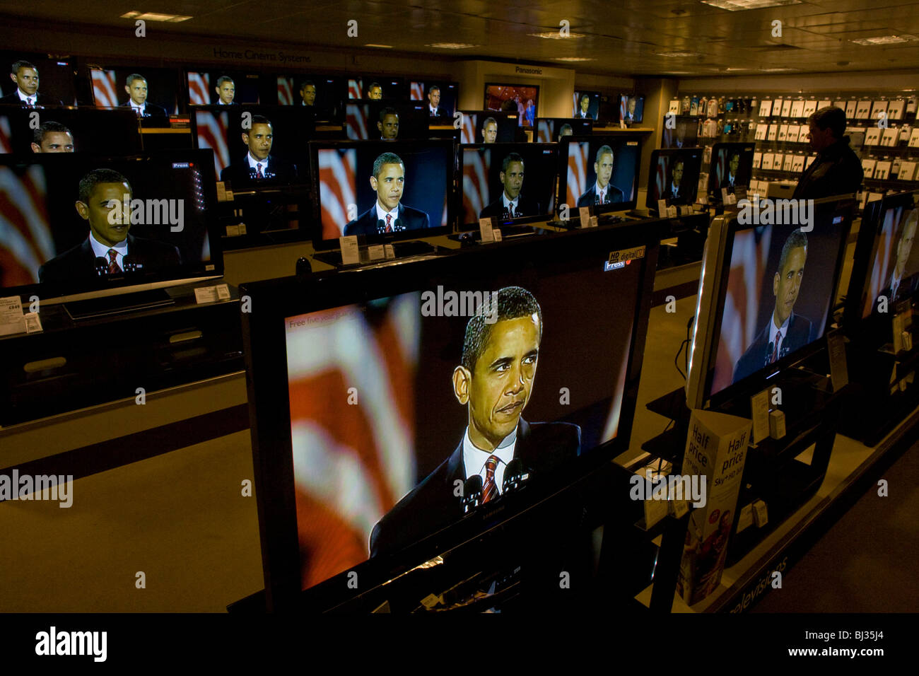 Barack Obama gives election victory speech on BBC News TV screens on audio floor of John Lewis department store - Stock Image