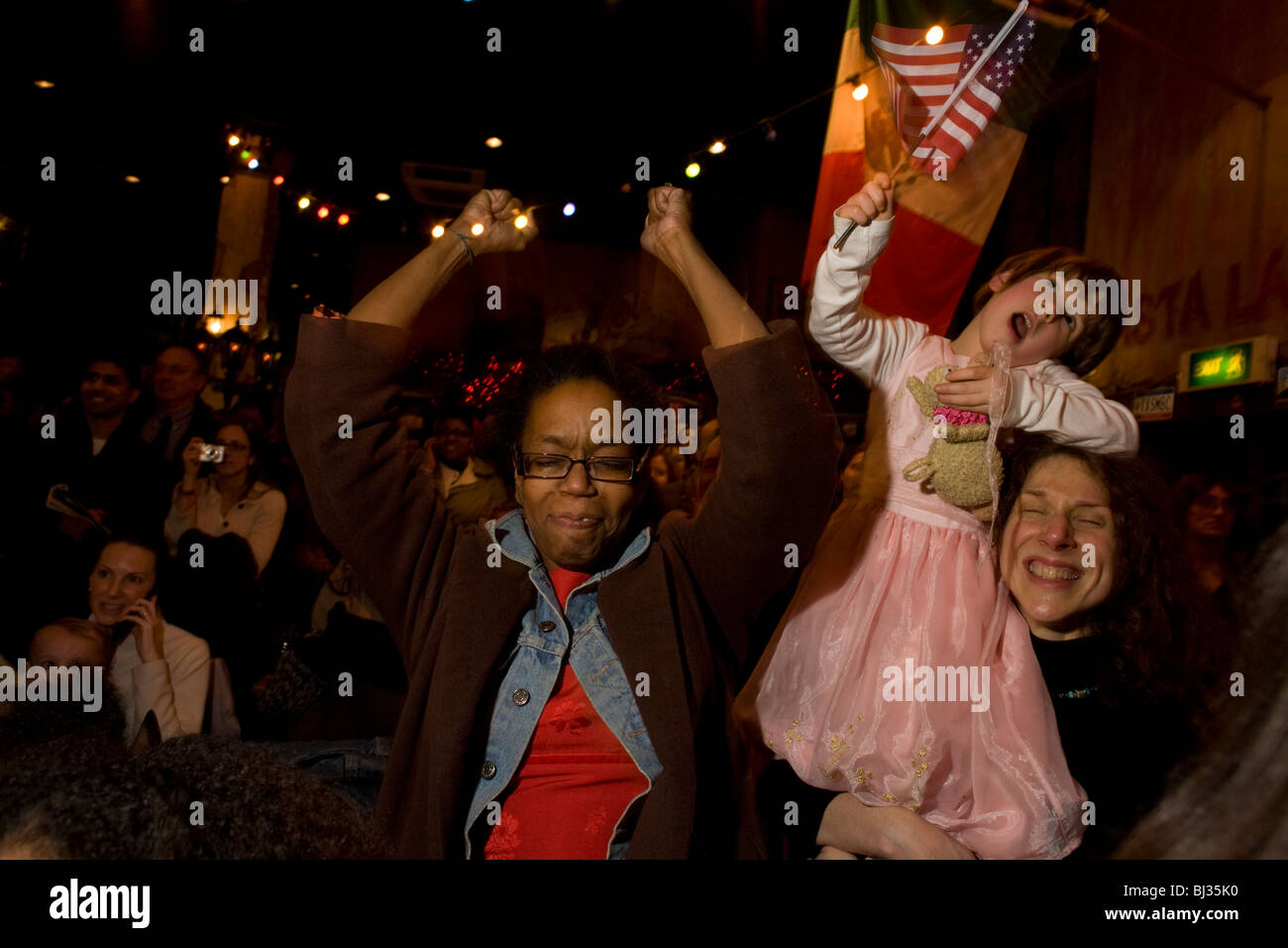Elated US citizens celebrate at the very moment of Barack Obama's inauguration as the United States' 44th President. - Stock Image