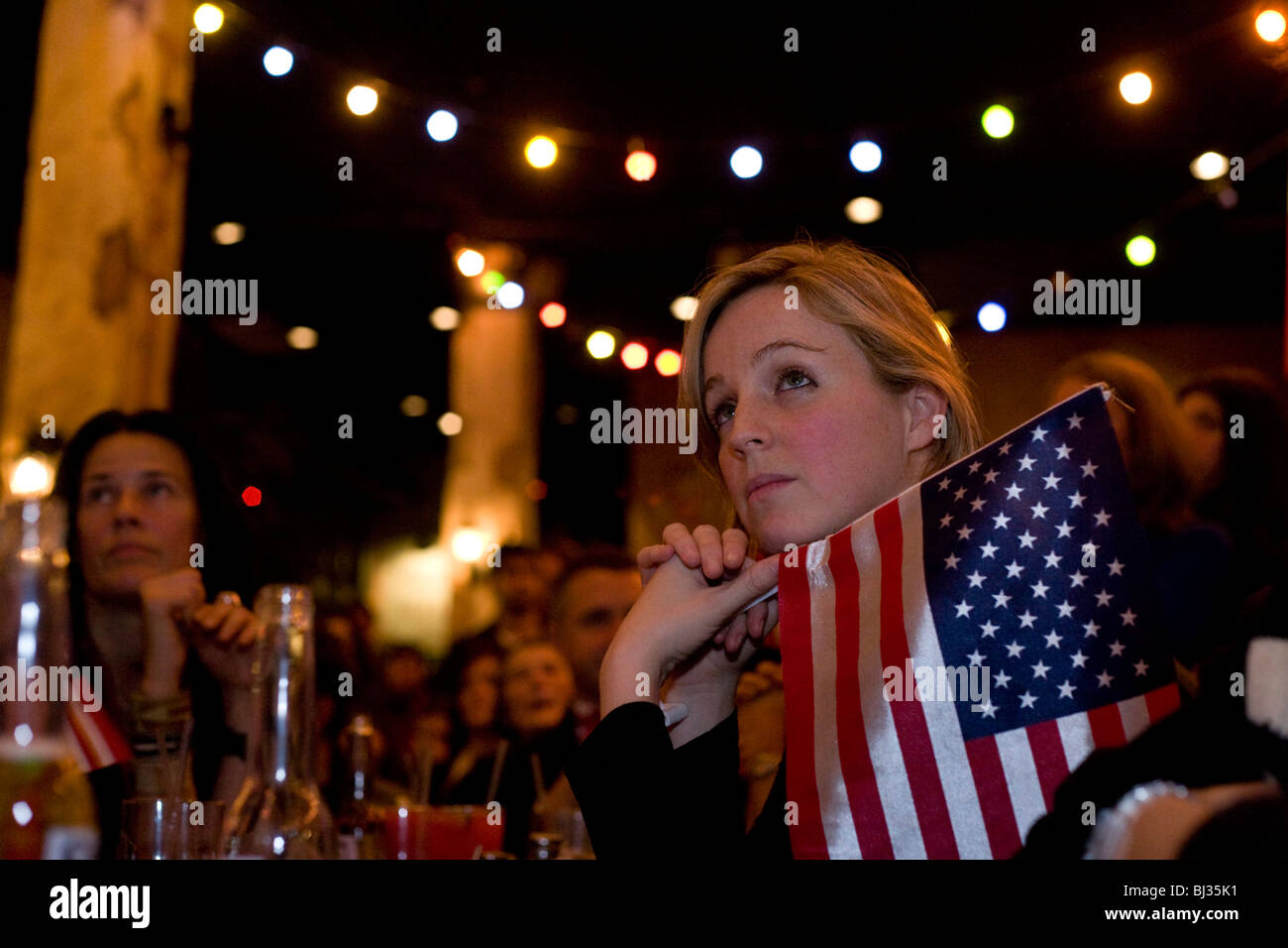 A US citizen listens spellbound to Barack Obama's inauguration speech. - Stock Image