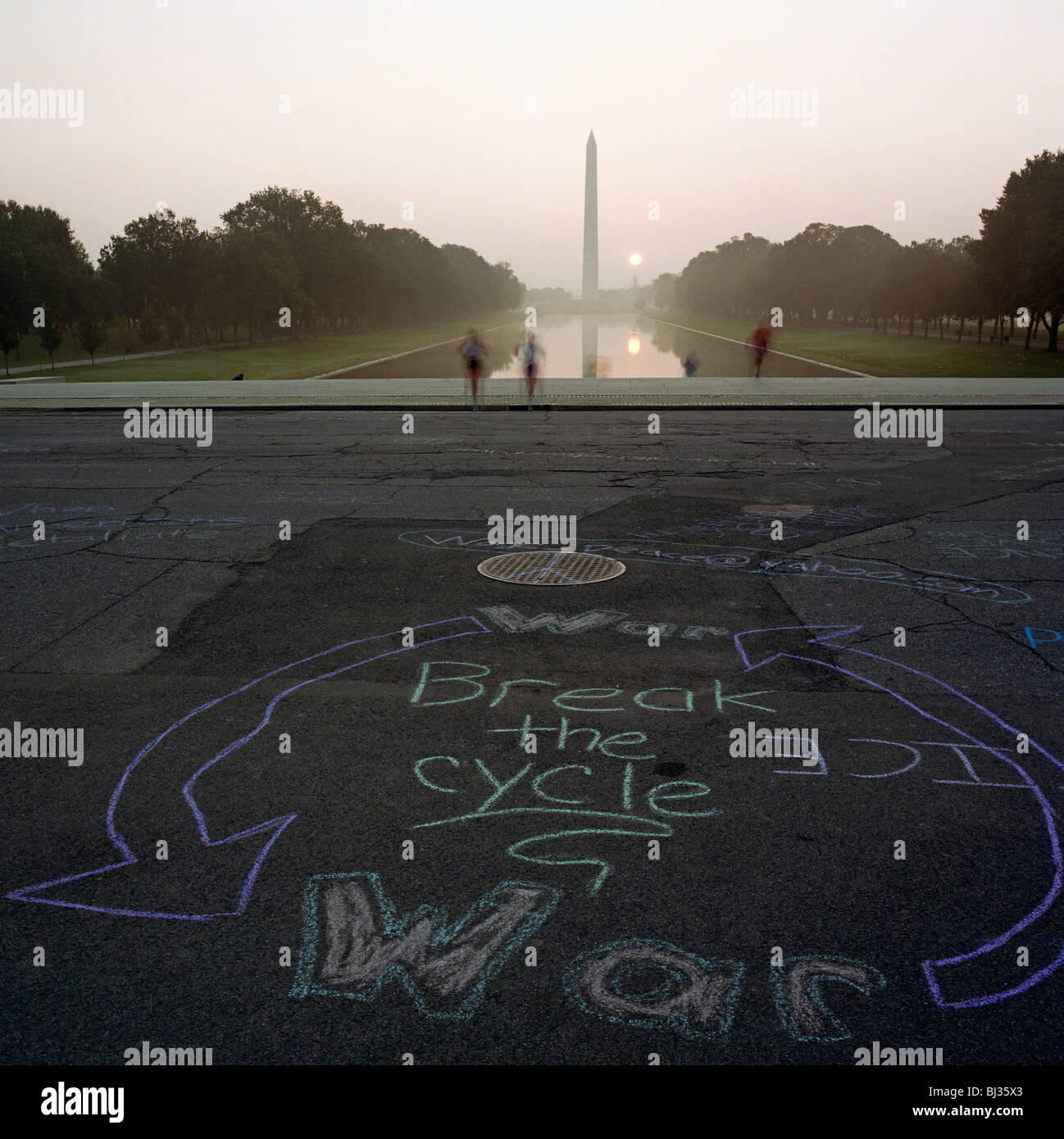 Anti-war graffiti written in a circular chalk graphic on the path in front of the Lincoln Memorial, Washington DC. Stock Photo