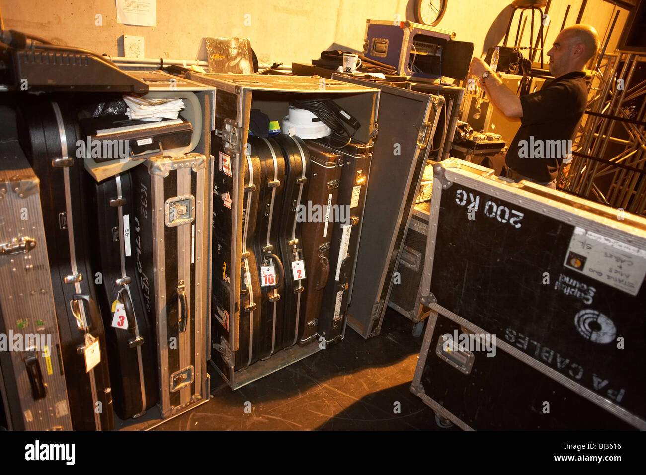 roadie belonging to the crew of British rock and roll band Status Quo starts packing up sound equipment and the - Stock Image