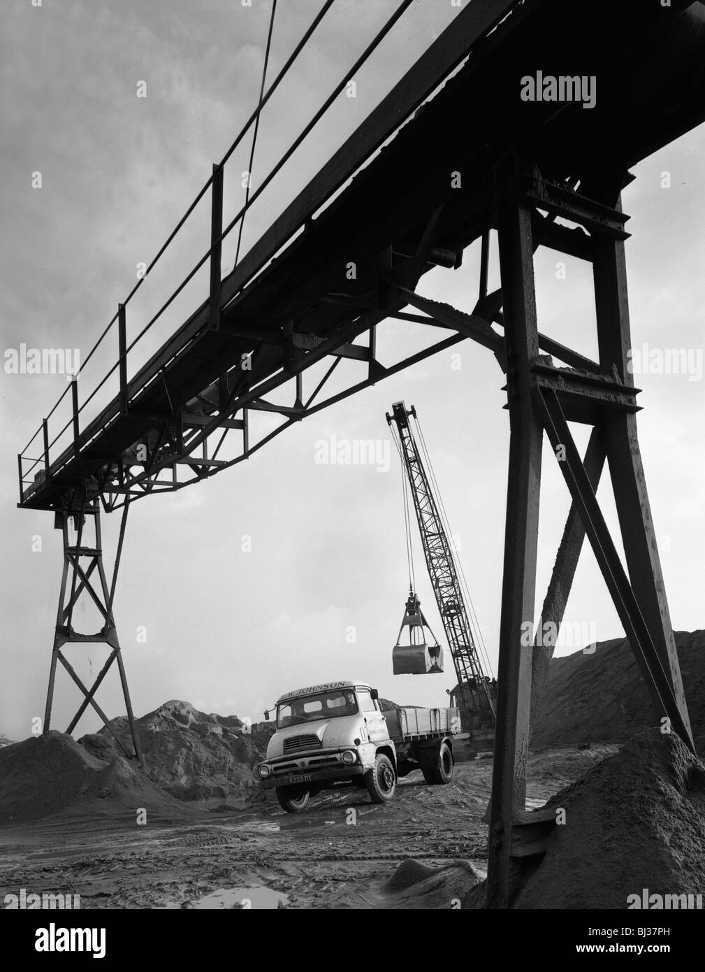 Loading a Ford Thames Trader tipper lorry, Finningley, near Doncaster, South Yorkshire, 1966. Artist: Michael Walters - Stock Image
