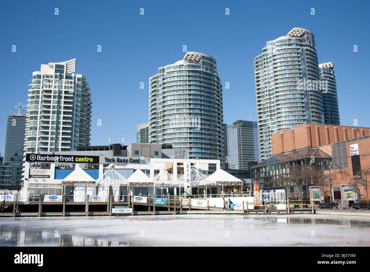 Luxury residential condo buildings in front of lake Ontario just right behind harbourfront center in the winter - Stock Image