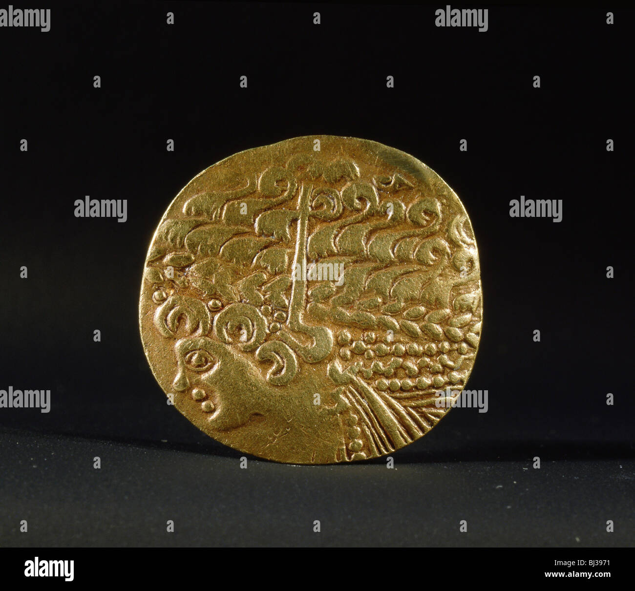 Gold coin belonging to the Ambiani, from the north of Gaul, 2nd century BC. Artist: Werner Forman - Stock Image