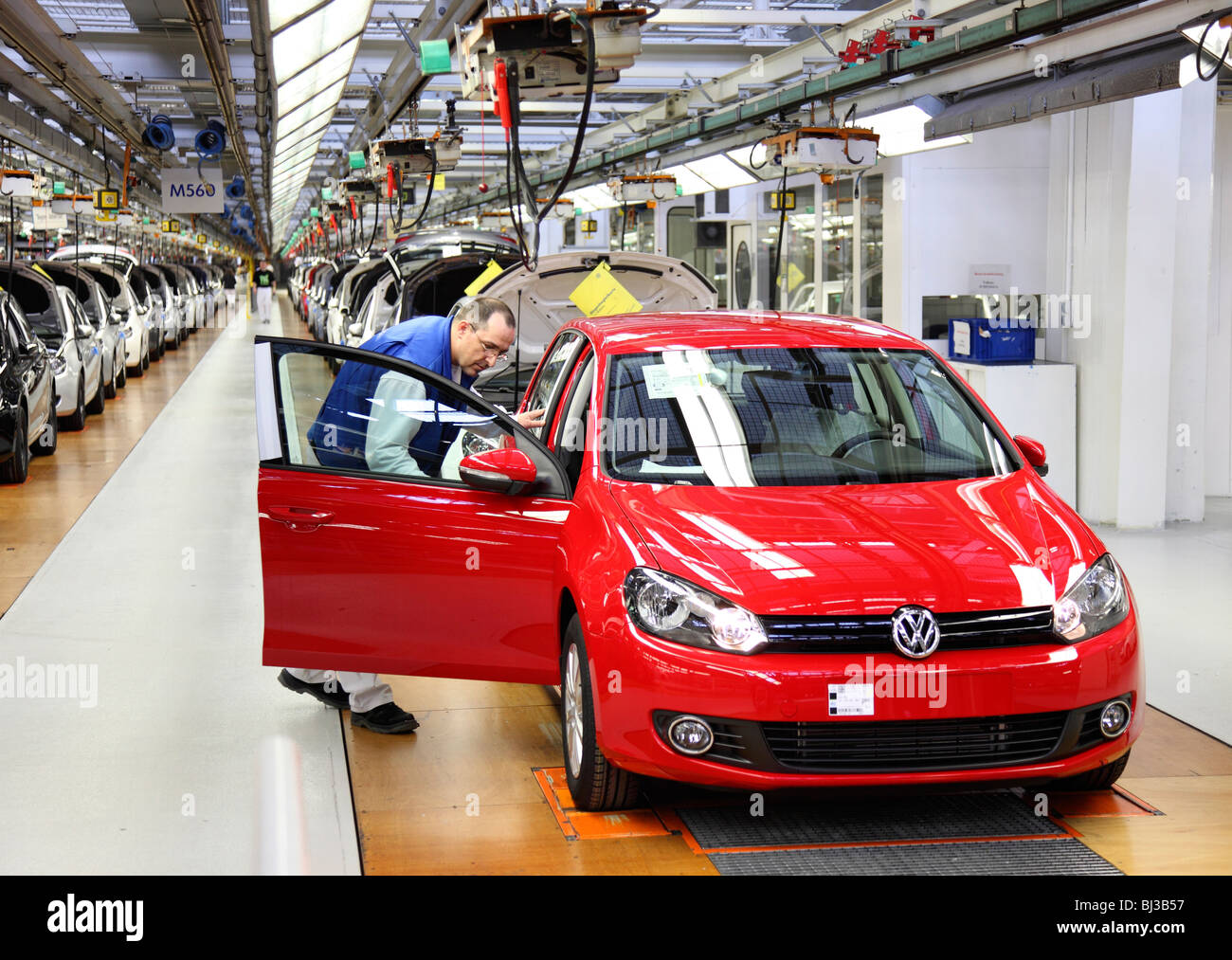 Volkswagen AG, production of passenger cars in the works in Wolfsburg. Final control of a Golf VI directly before - Stock Image