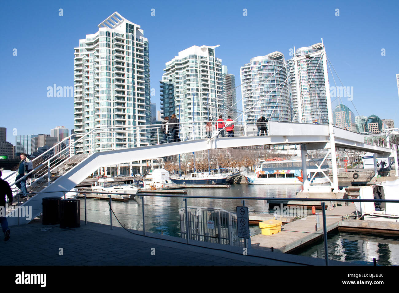 Luxury condo residential buildings in front of lake ontario just right behind harbourfront center in the winter - Stock Image