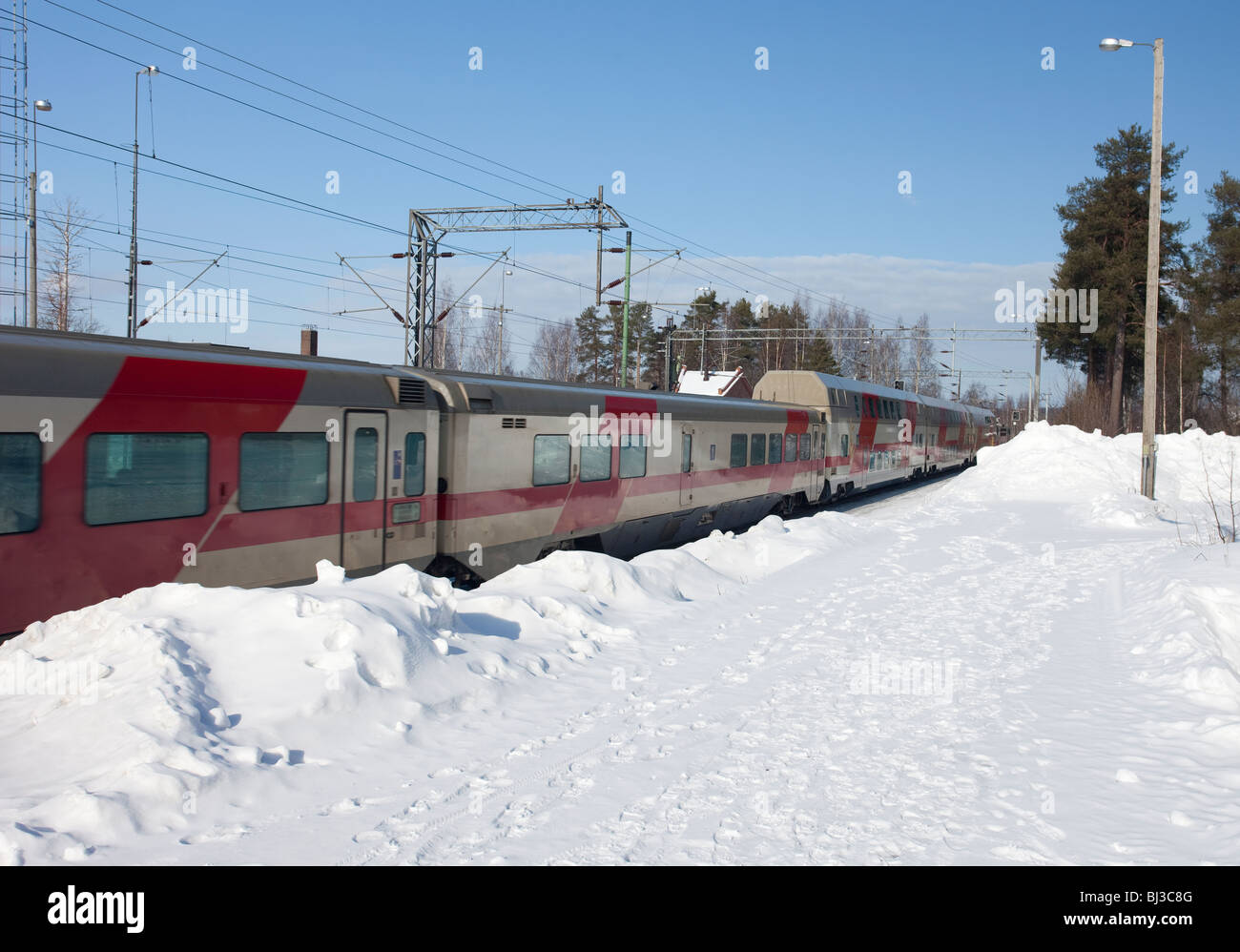 Finnish long distance train leaving from railroad station at Winter , Finland - Stock Image