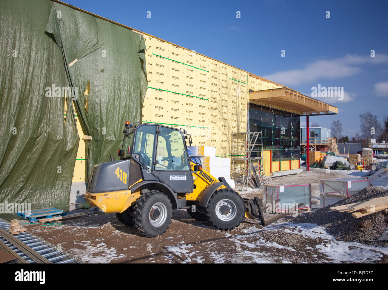Construction site where the outer insulation sheathing has been installed to the wall , Finland - Stock Image