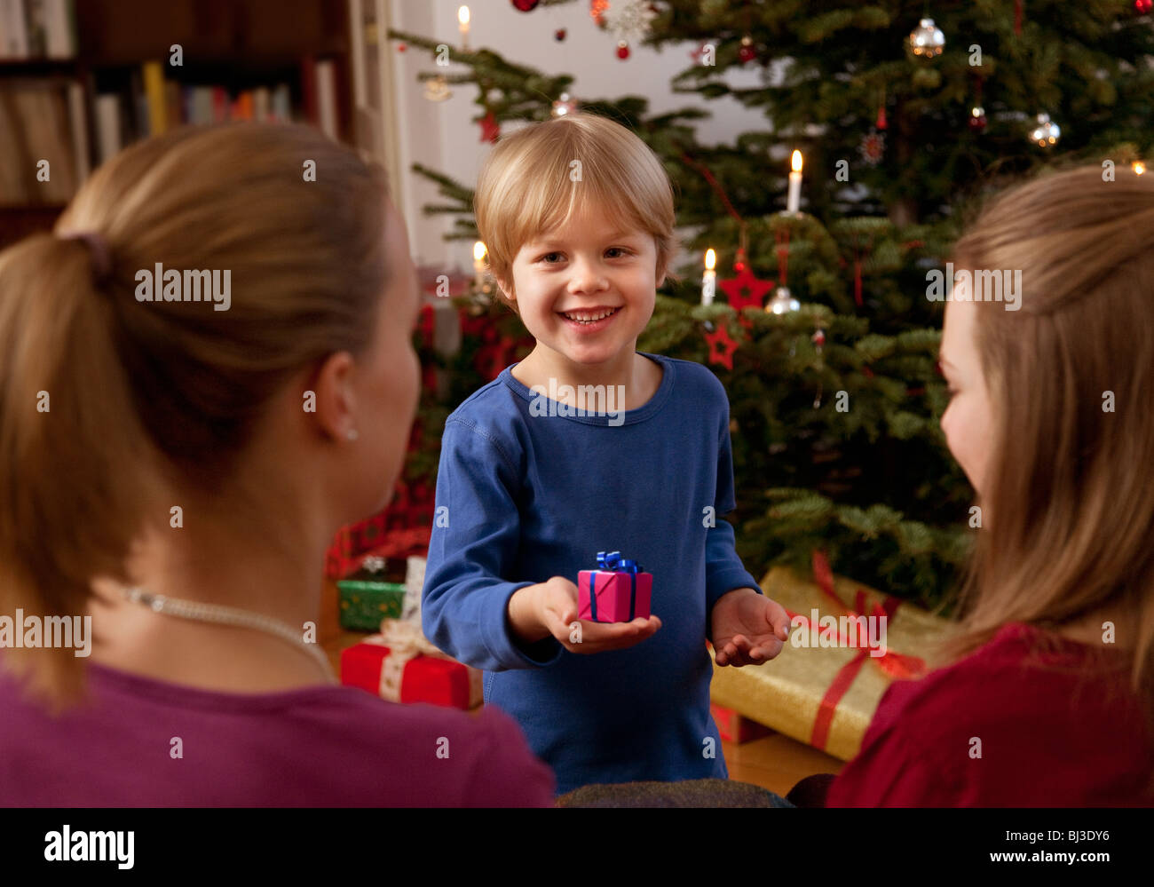 boy showing small christmas present Stock Photo