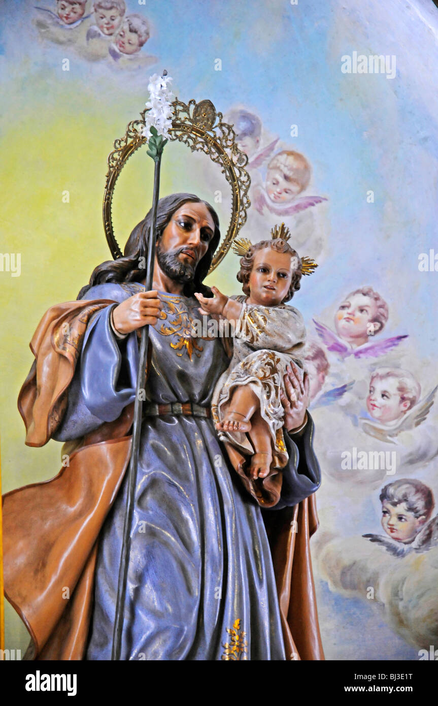 Figure of a saint, child, angel, painting, church of San Jaime, Benidorm, Costa Blanca, Provinz Alicante, Spanien, Stock Photo