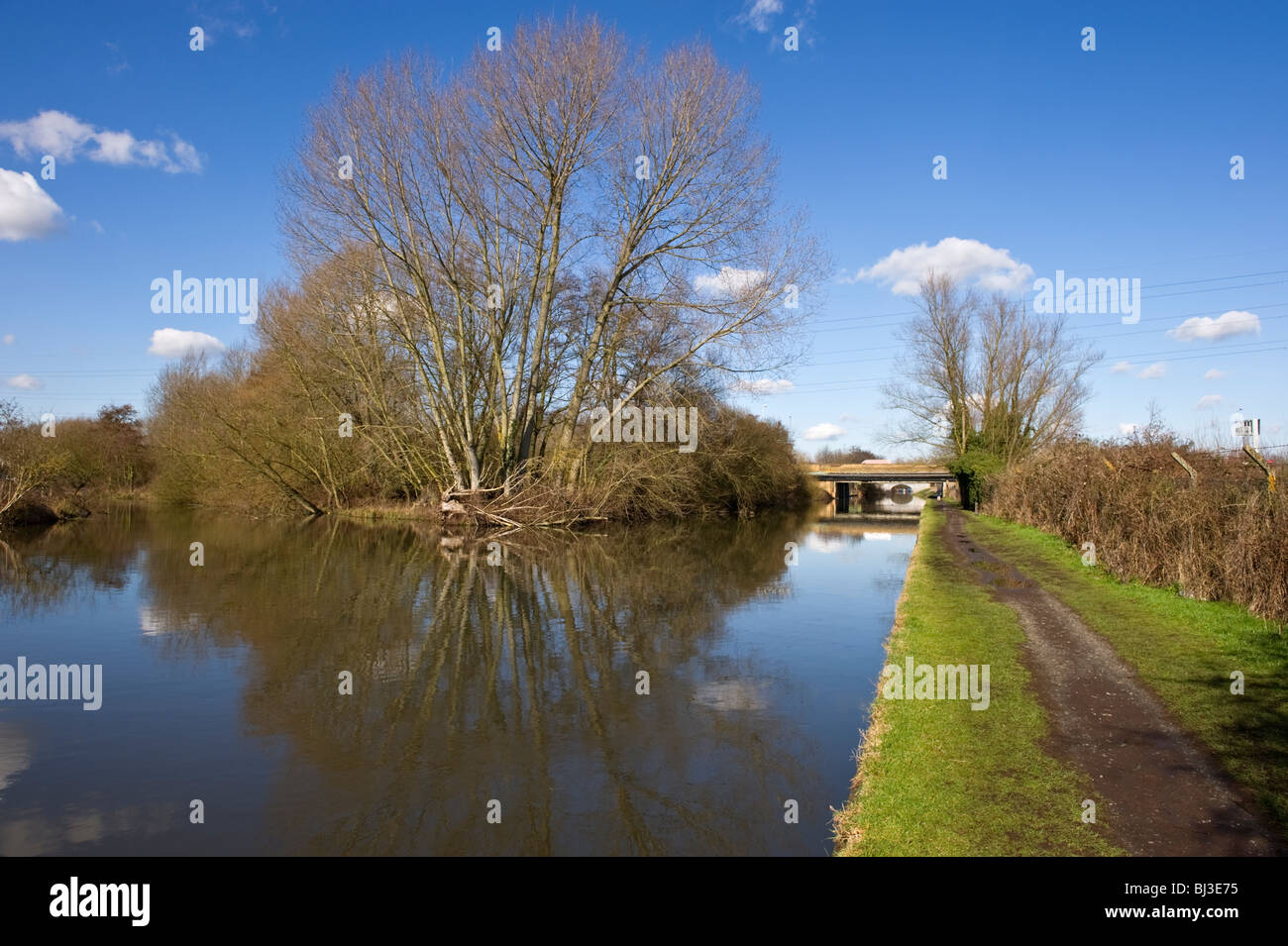 Grand Union canal and towpath and blue sky at Uxbridge Middlesex  West London UK - Stock Image