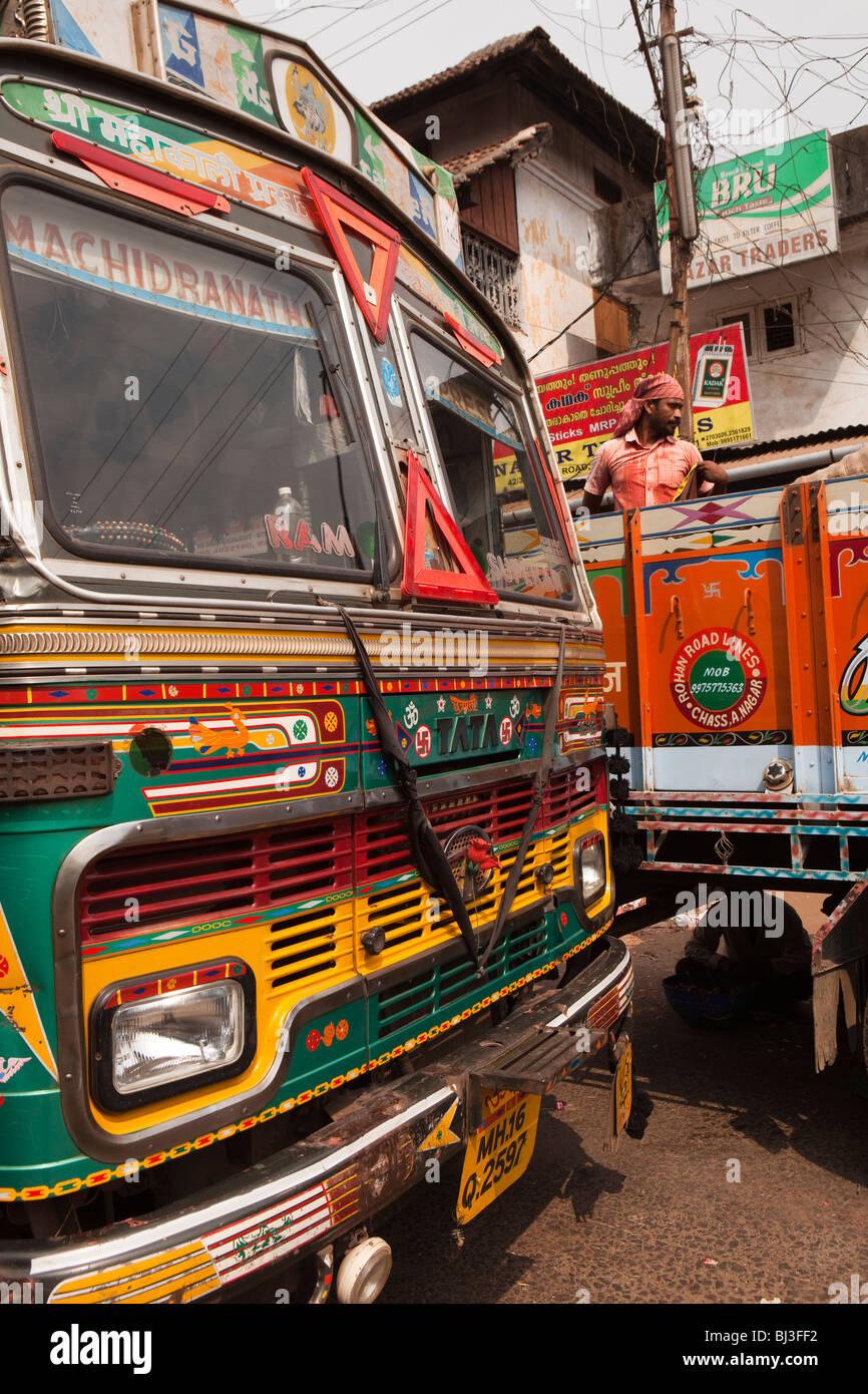 India, Kerala, Calicut, Kozhikode, Big Bazaar, decorated trucks from Maharashtra being unloaded - Stock Image