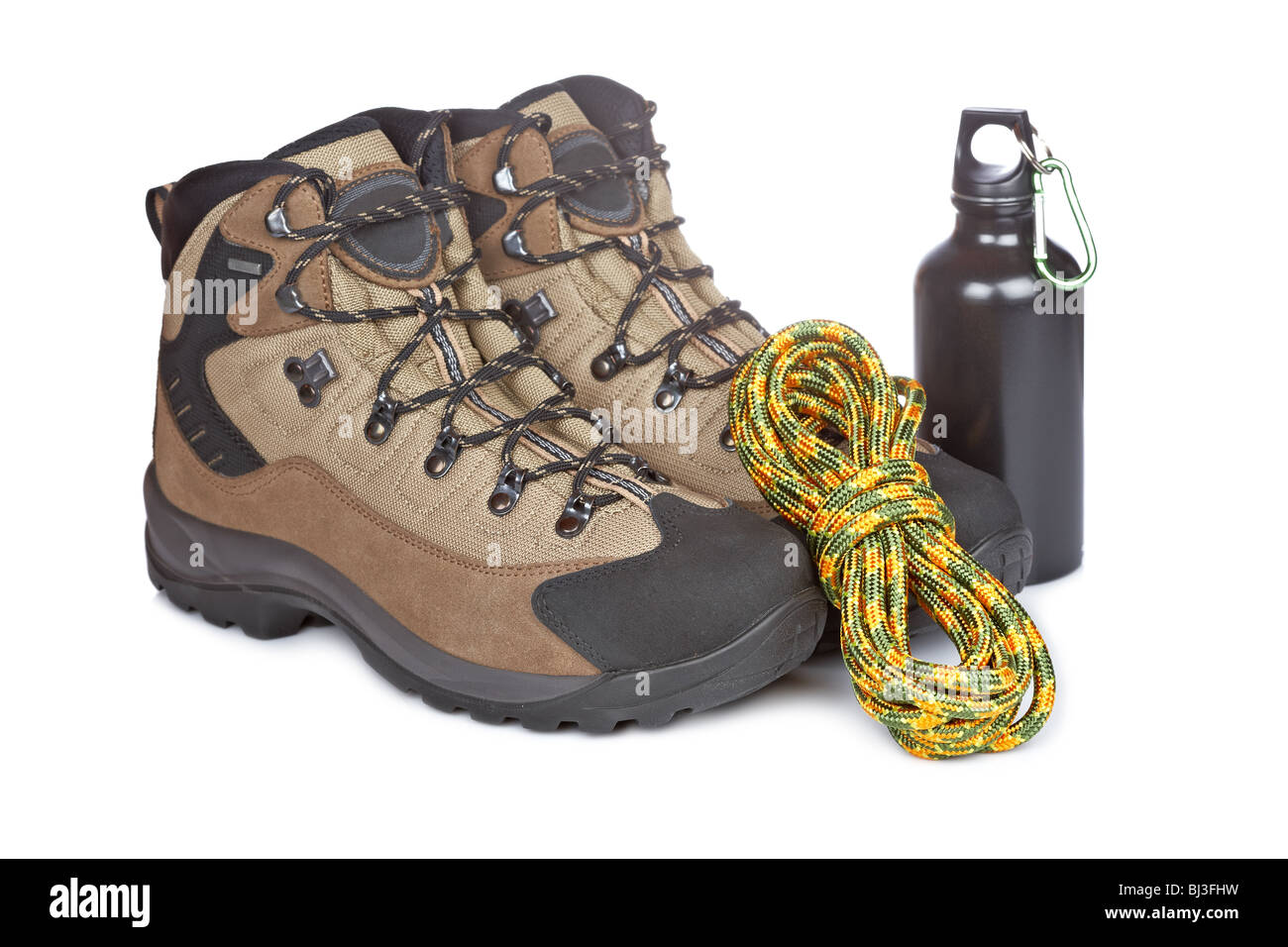 Hiking boots, canteen and rope reflected on white background. Shallow depth of field - Stock Image