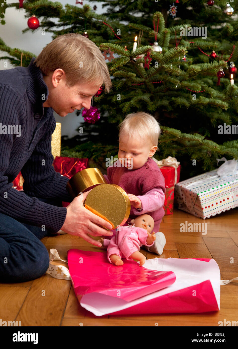 father, baby opening christmas present Stock Photo