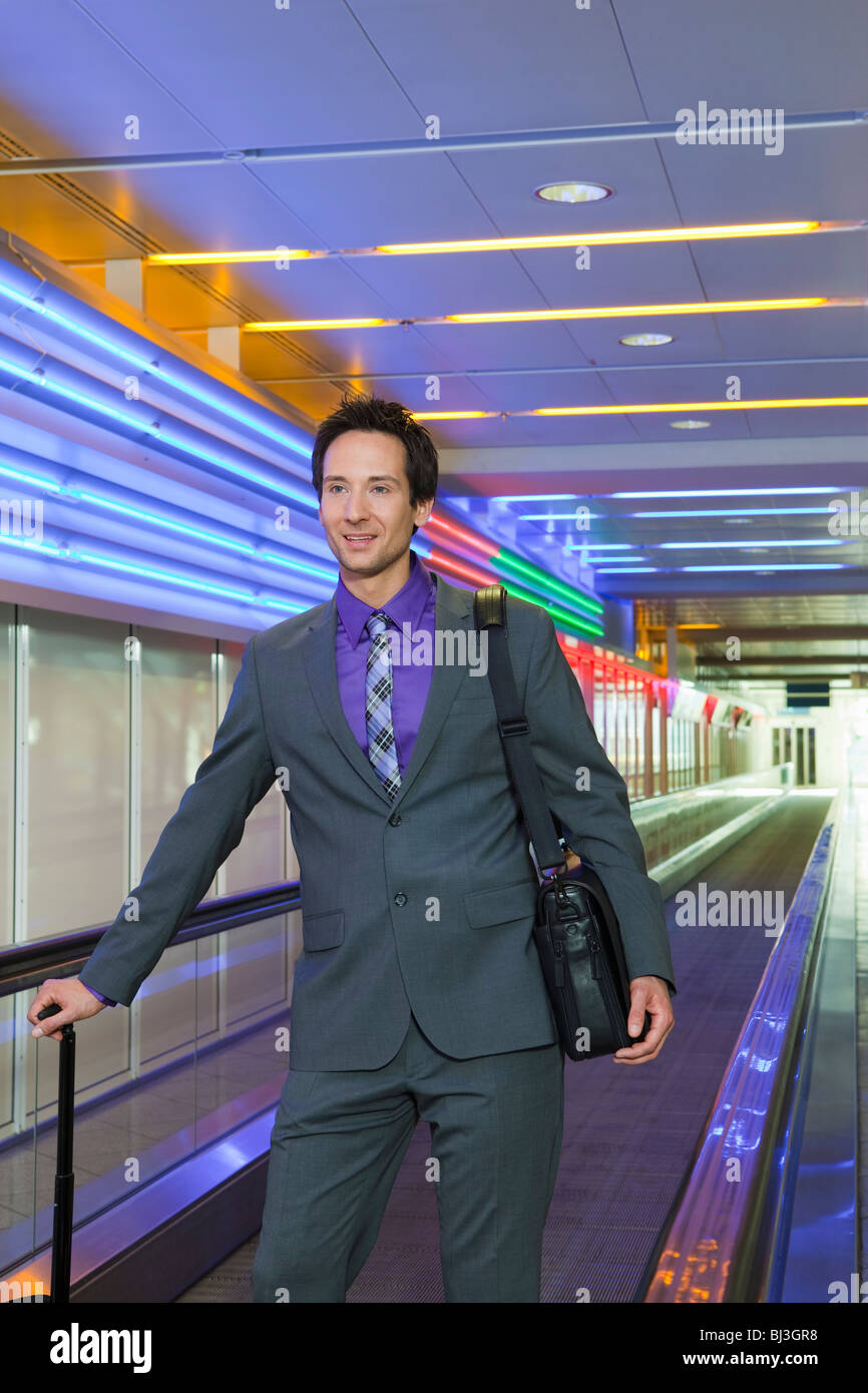 business man on conveyor belt - Stock Image