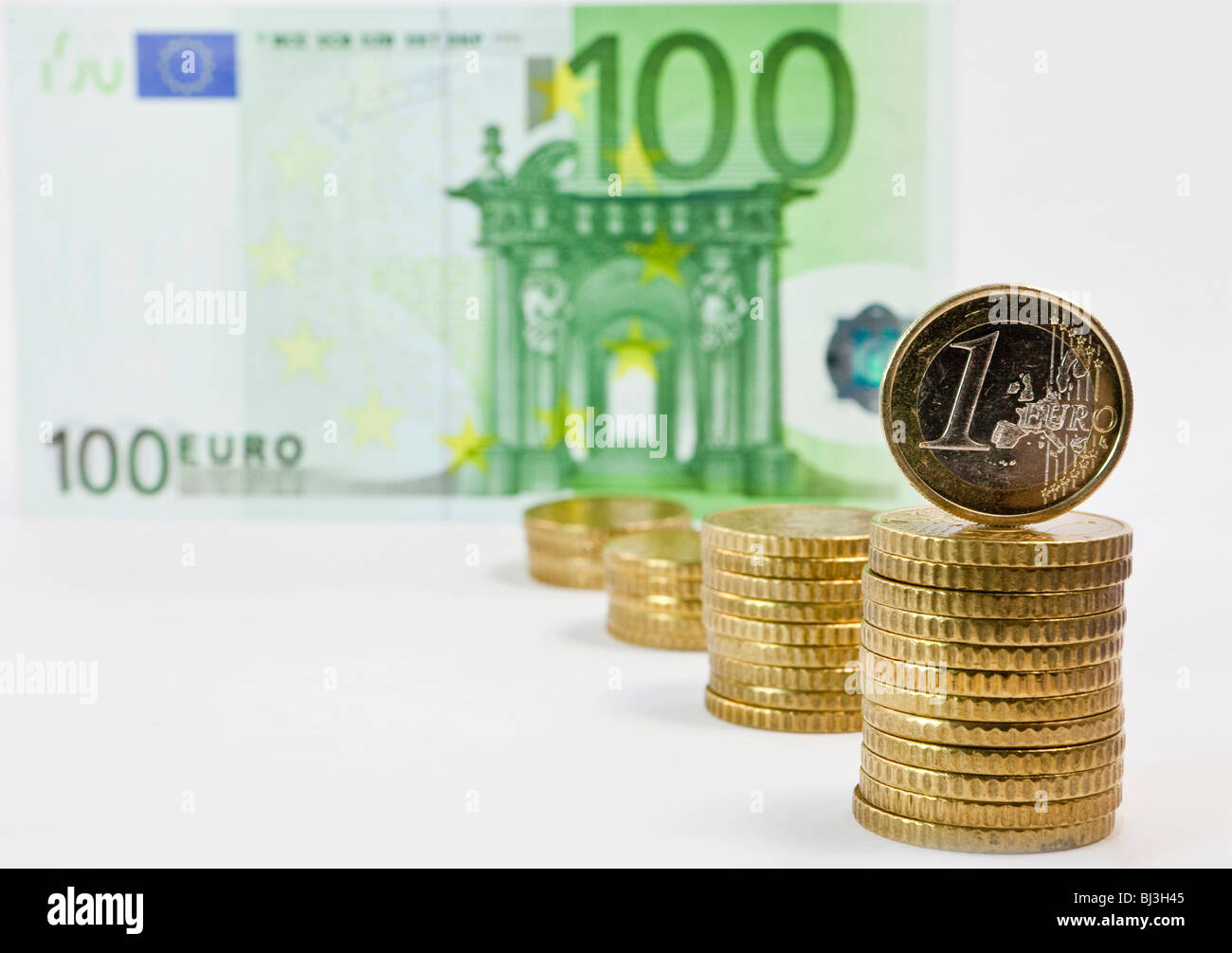 Euro and 50 euro cent coins, 100 euro bill - Stock Image