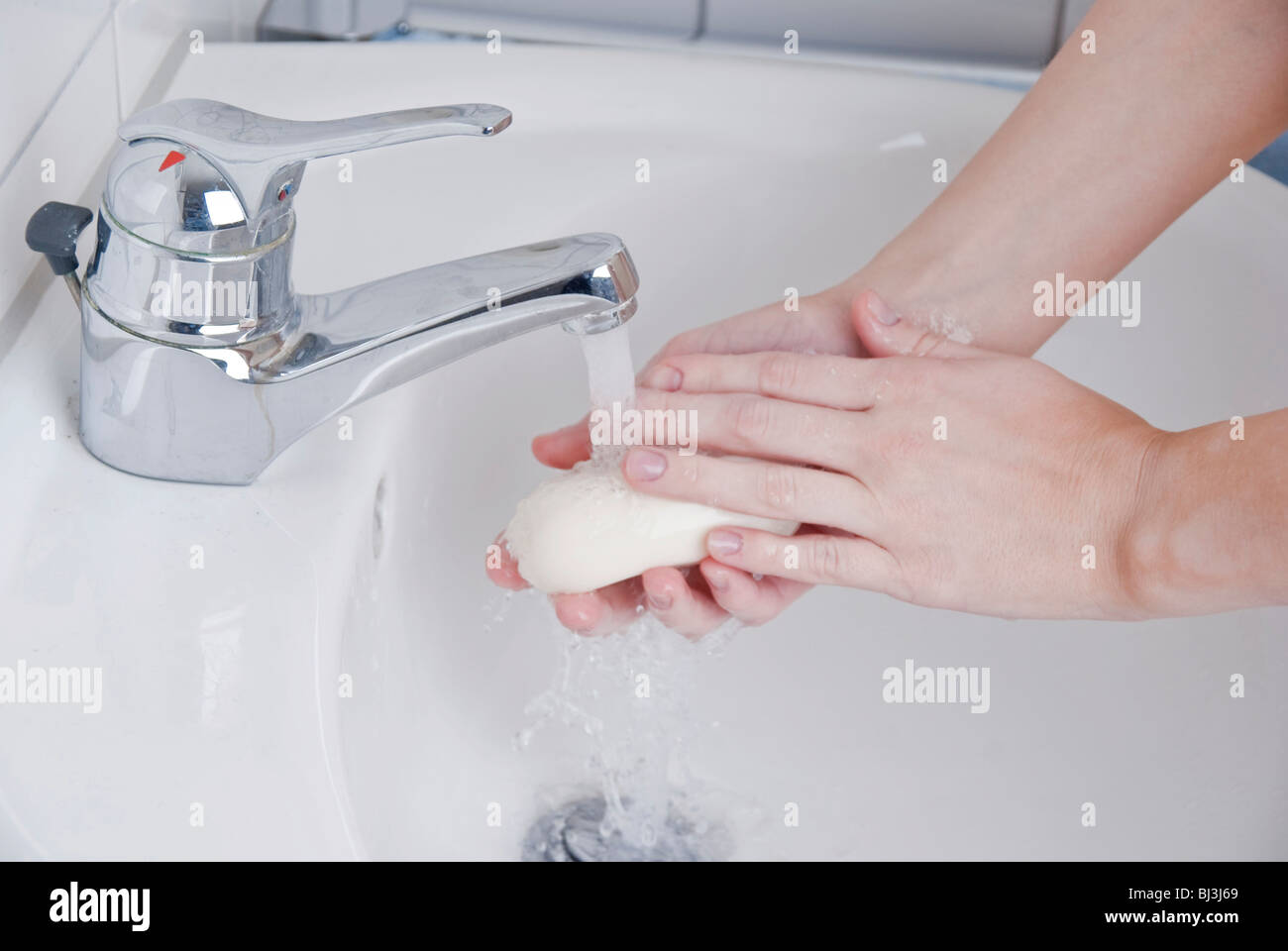 Women washing her hands with soap Stock Photo
