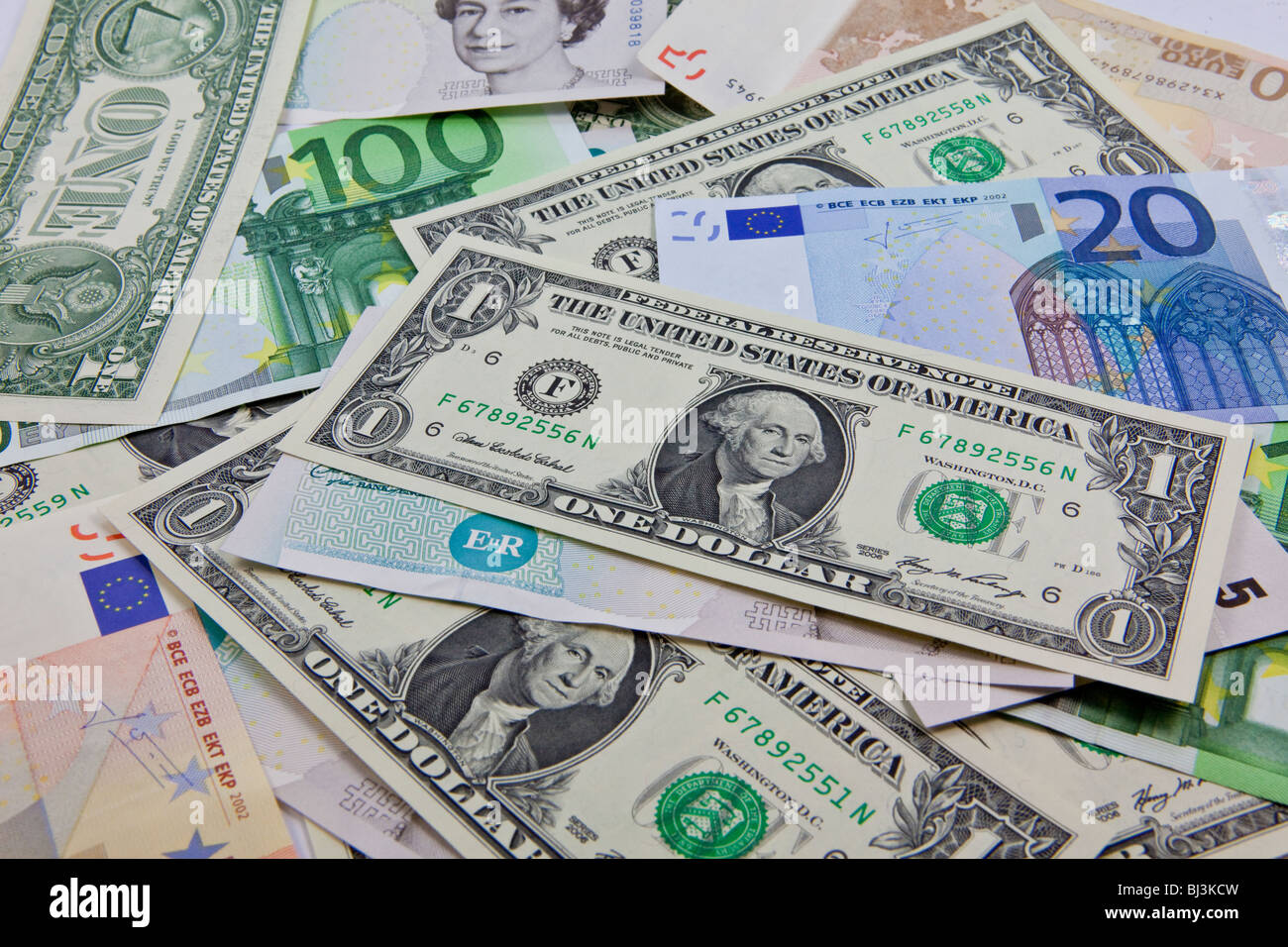 A mixture of bank notes, U.S. dollars, euros and British pounds Stock Photo