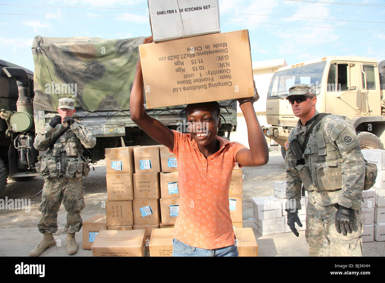 Woman receiving humanitarian aid after the earthquake of January 2010 in Port au Prince, Haiti - Stock Image