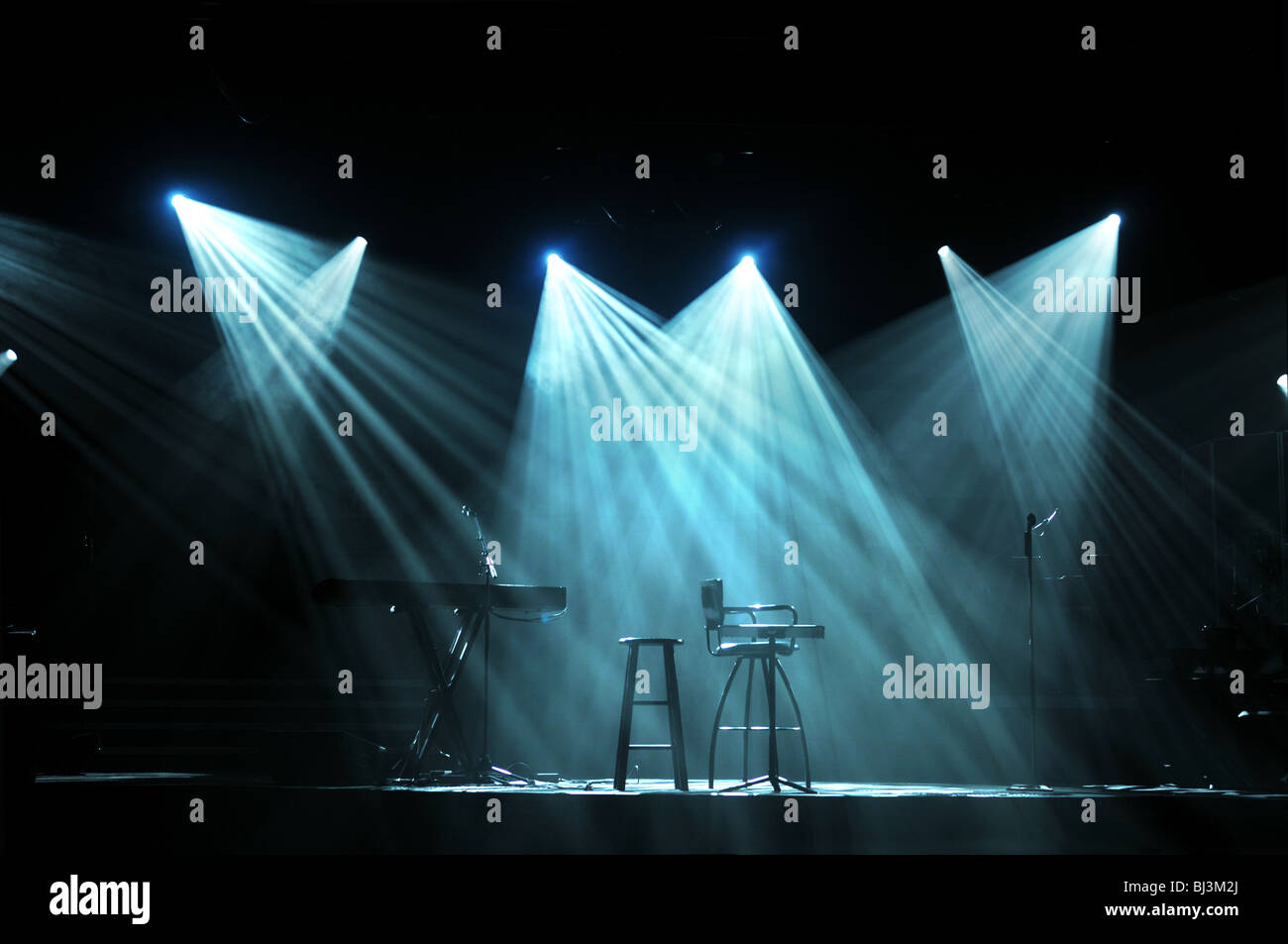 Stage with bright lights and microphones ready for concert - Stock Image