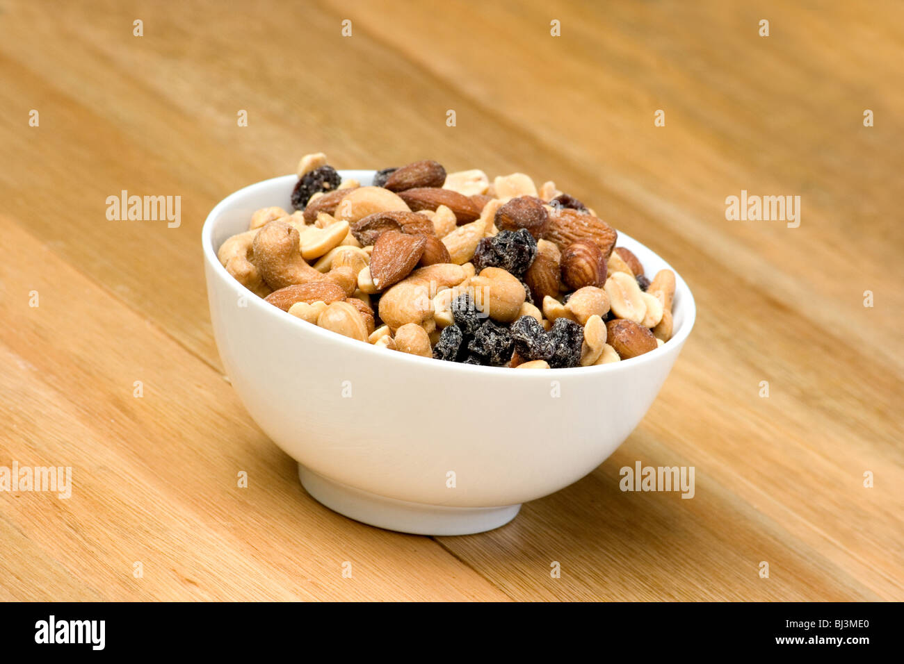 Mixed nuts in a bowl - Stock Image