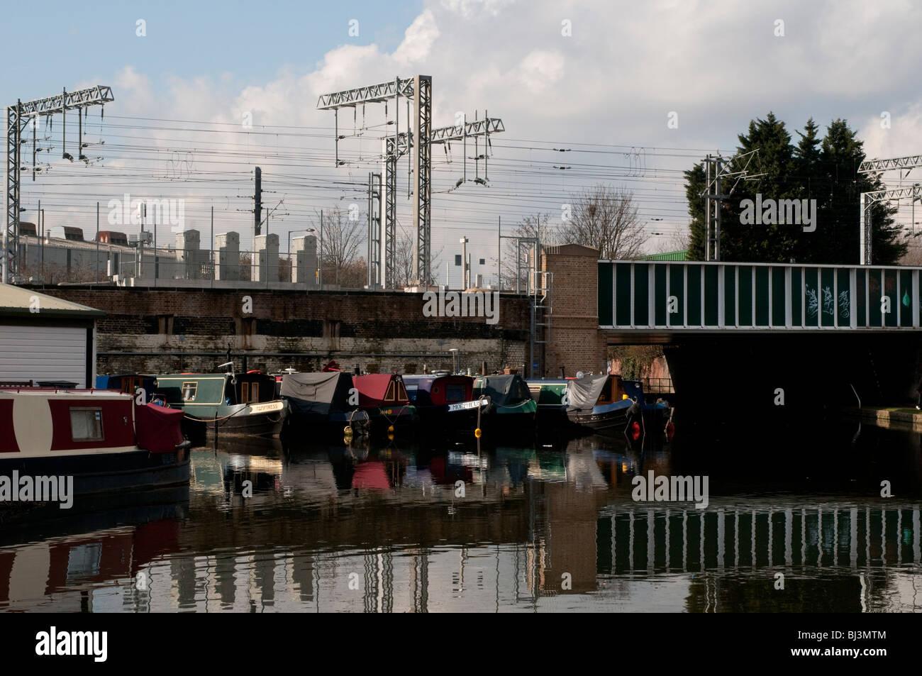 Boats on Regents Canal near the railway lines, Kings Cross, London, UK - Stock Image