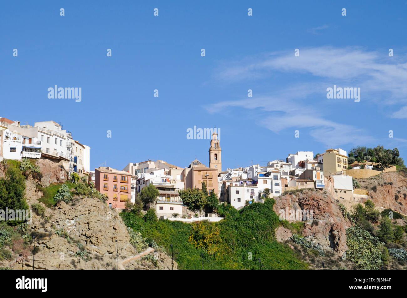Houses, churches, steep, mountain village, Finestrat, Costa Blanca, Alicante province, Spain, Europe - Stock Image