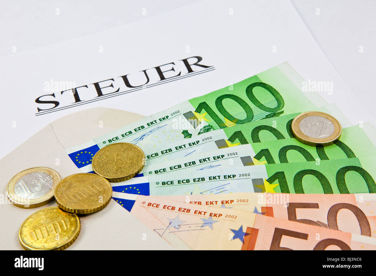 Envelope with euros, tax money - Stock Image