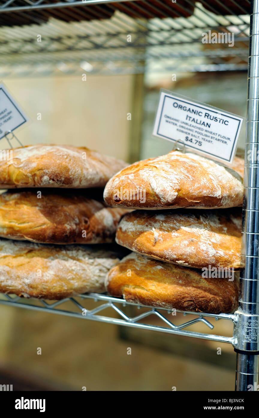 Artisan Bread on Display at a retail bake shop - Stock Image