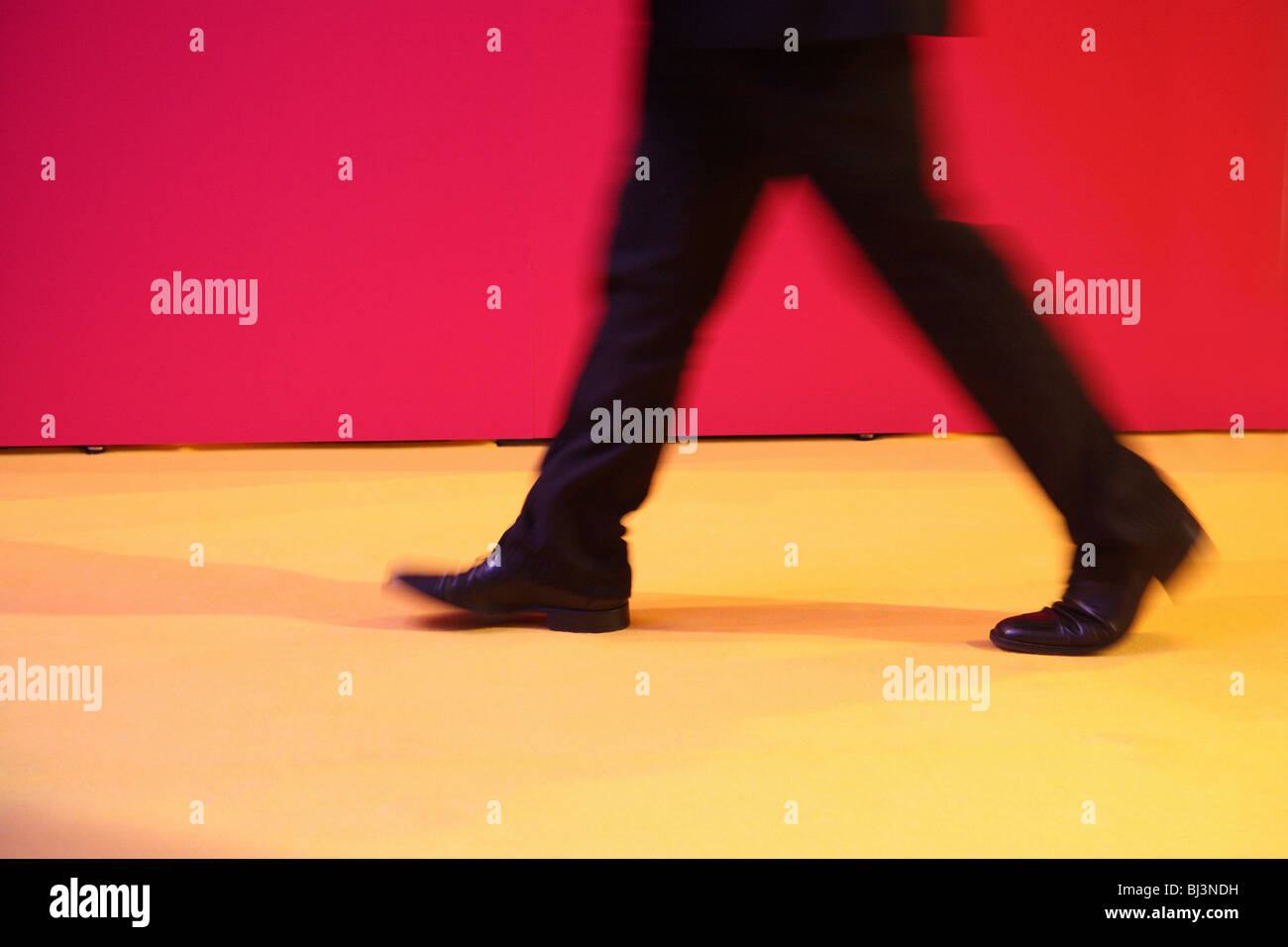 Legs of a walking man - Stock Image