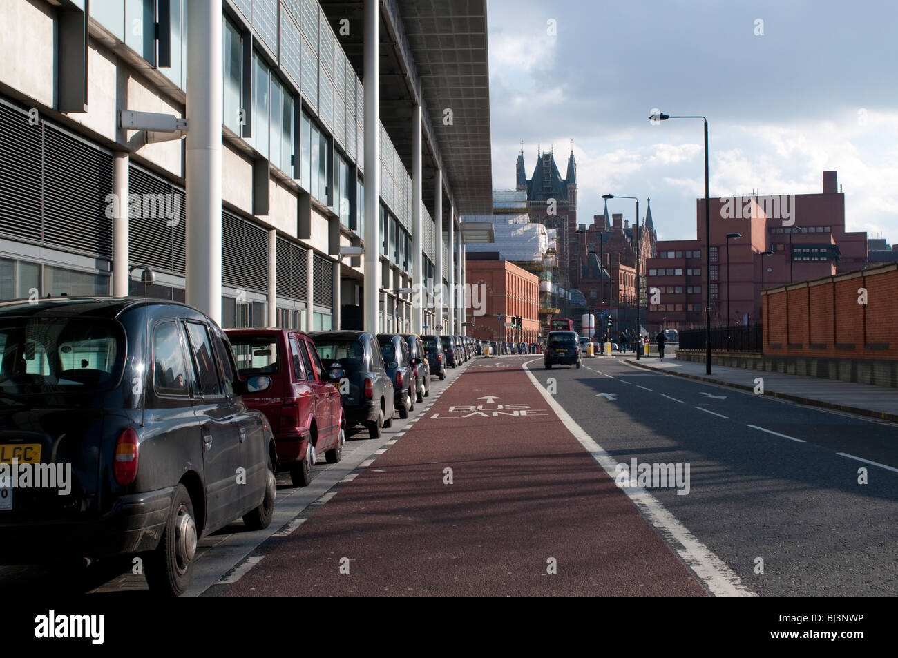 London cabs lined up along St Pancras Station, London, UK - Stock Image