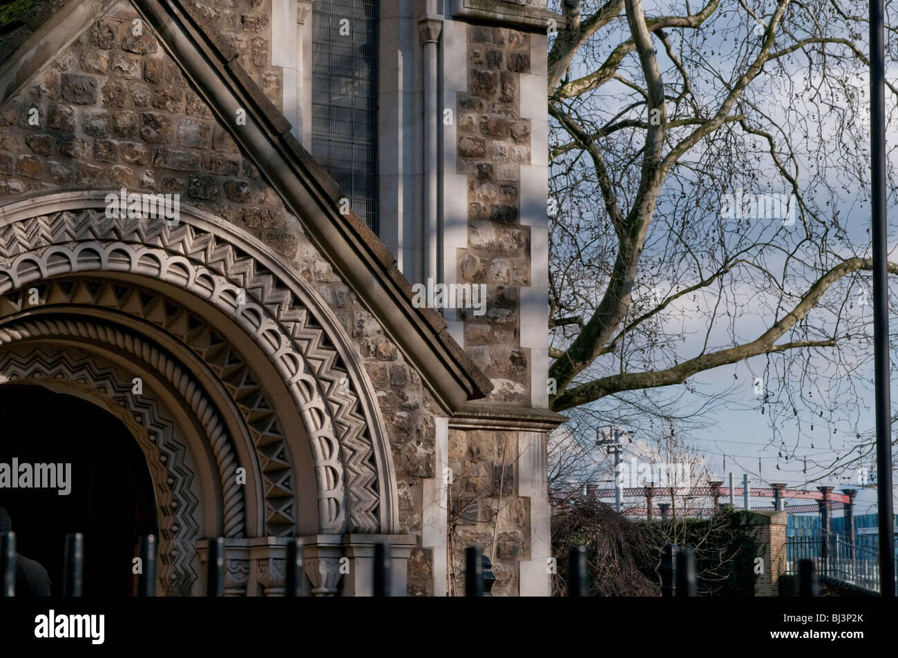 St Pancras Old Church and Kings Cross Gas holder in distance, London, UK - Stock Image