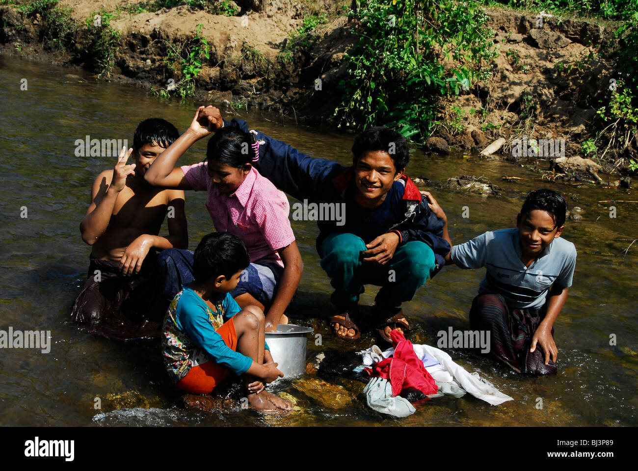 karen burmese refugee's washing clothes in stream , mae la  refugee camp(thai burmese border) , north of mae sot Stock Photo